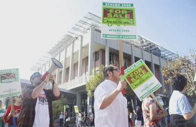 Members of AFSCME Local 3299 congregated at the intersection of Bancroft Way and Telegraph Avenue in October 2015 to protest UC Berkeley's conduct toward contract workers.