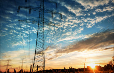 Electricity industry high voltage towers at sunset