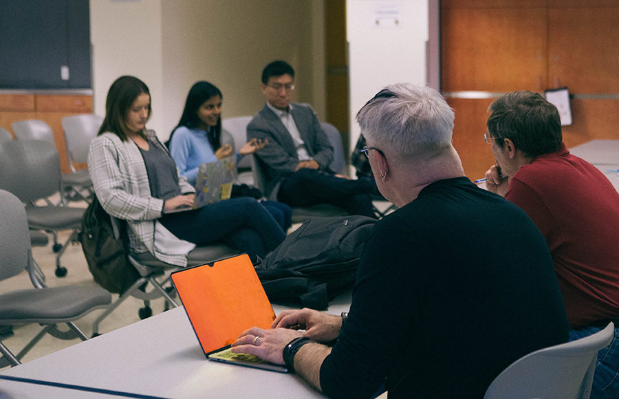 """Students give feedback to the university regarding new data science associate """"provost"""" during a meeting."""