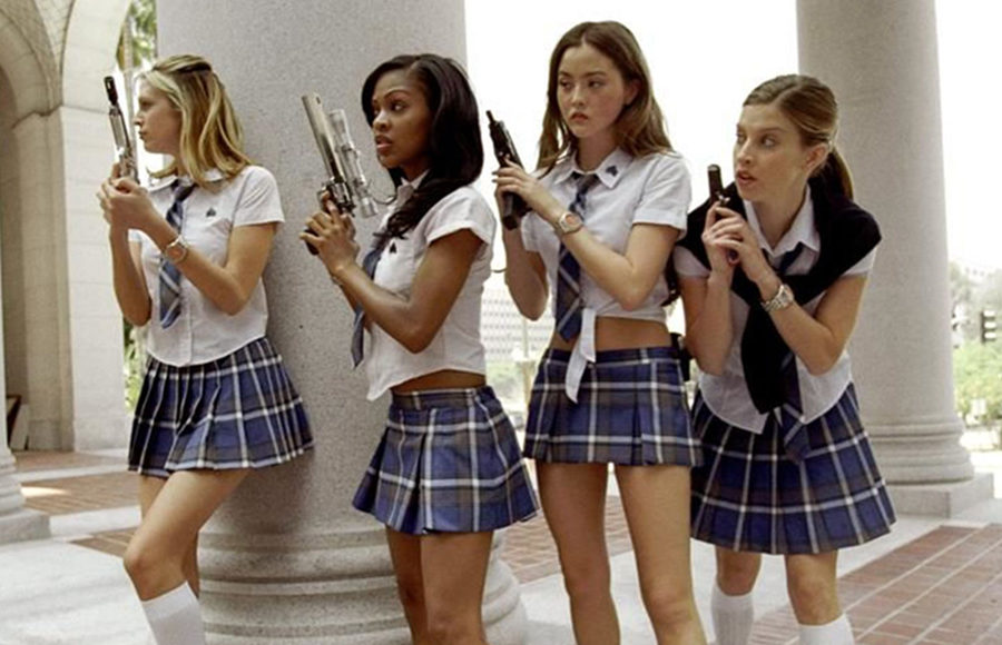 Four women dressed in school girl outfits hold up guns.