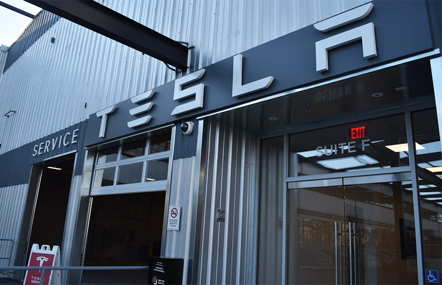 "Large metal building with the word ""TESLA"" on it in large letters."
