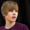Circa 2011 Justin Bieber looks to distance with a perplexed expression.
