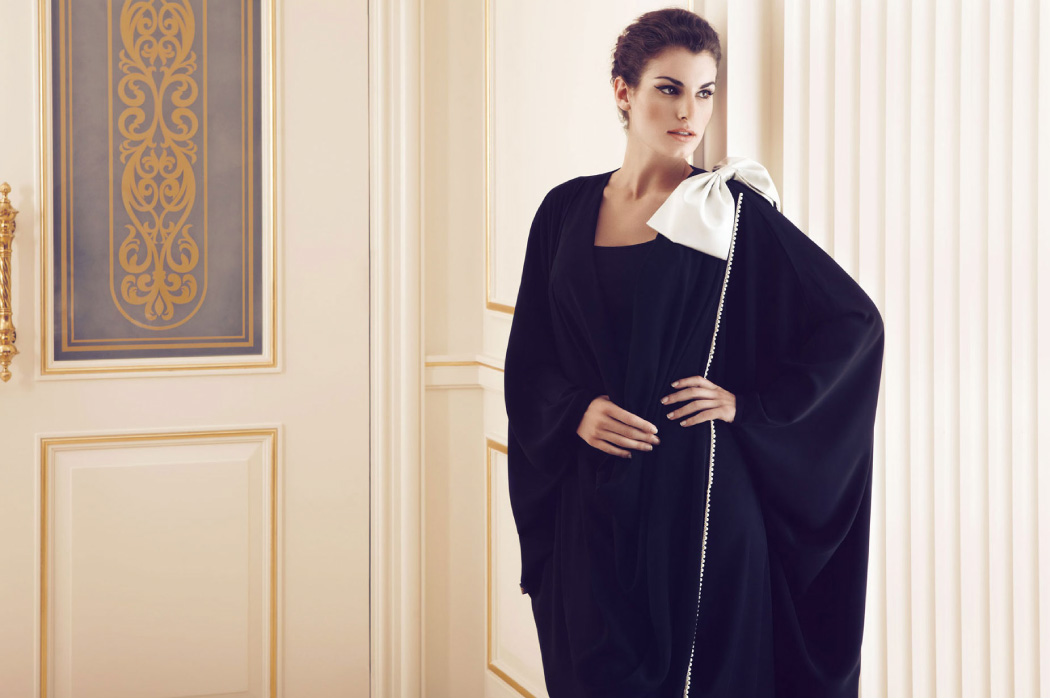 This bow over the shoulder adds instant charm to this abaya