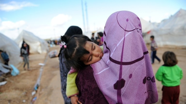 """Nine human rights organisations issued a statement on Saturday condemning """"hate speech"""" from local media outlets against Syrian and Palestinian refugees in Egypt (Photo AFP/ Bulent Kilic)"""