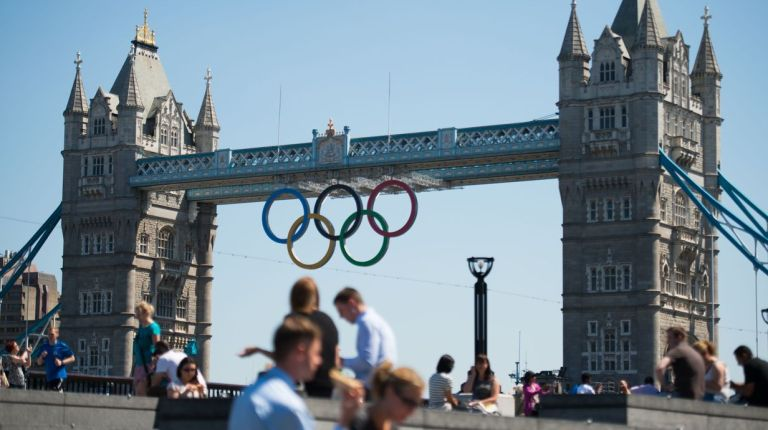 Olympic rings hang from London's landmark Tower Bridge as the city prepares to host the games of 30th Olympiad