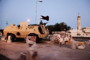 Egyptian soldiers stand on top of an Egyptian armoured personnel carrier at a military checkpoint on the Egyptian side of Rafah AFP PHOTO/MOSTAFA ABULEZZ
