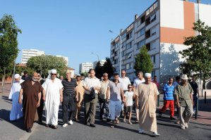 French imam (3rdL) of the Faourette mosque takes part on 14 August in a march with residents to ease people's minds, two days after clashes broke out between rival groups in the Bagatelle and Farouette deprived neighbourghoods of Toulouse, southern France AFP PHOTO / PASCAL PAVANI