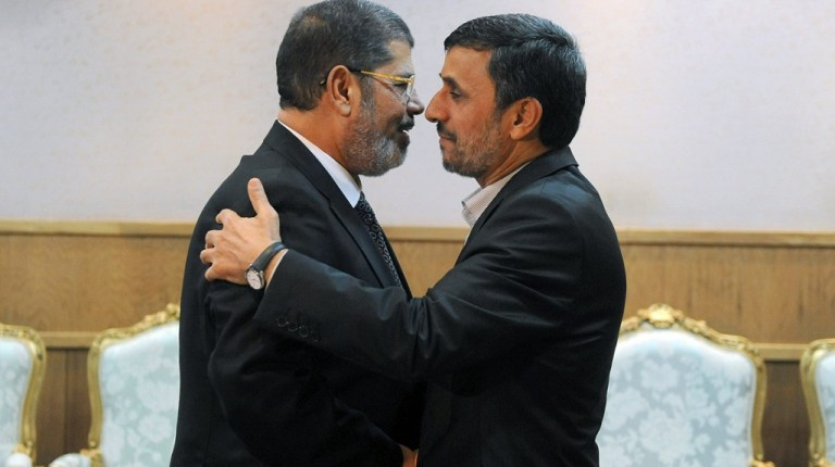 Iranian President Mahmoud Ahmadinejad (right) welcomes his Egyptian counterpart Mohamed Morsi during a meeting on the sidelines of the Non-Aligned Movement summit in Tehran on 30 August AFP PHOTO/IIPA/SAJAD SAFARI