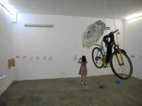 Artist photographing own work during exhibition