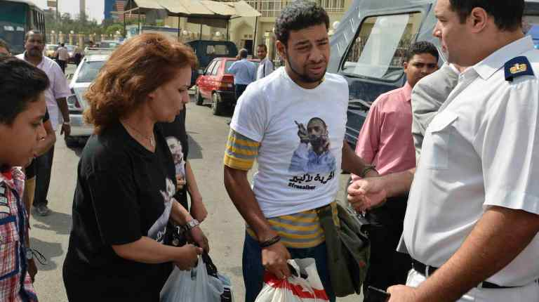 Alber Saber's mother, left, and supporters arrive for a hearing in his court case (File photo) Mohamed Omar