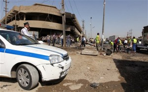 raqis inspect the site of a car bomb in central Baghdad Photo: SABAH ARAR/AFP/Getty Images