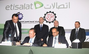 The signing of the partnership agreement between Etisalat Egypt and Kharafi's Arab Company for the Manufacture of Computers. (Photo courtesy of the Etisalat Egypt)