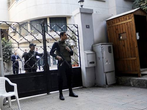 Secruity forces stand outside one of the NGOs (AFP Photo)