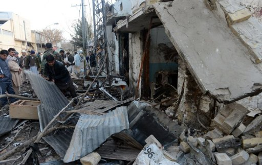 Collapsed structures and debris are seen at the site of twin suicide bombings in Quetta on January 11, 2013 (AFP, Banaras Khan)
