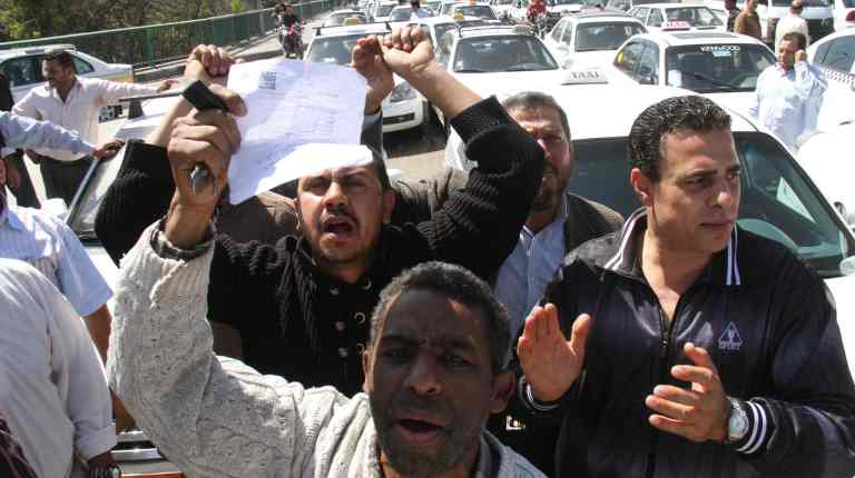 The Association for White Taxi Drivers announced on Saturday that it would hold a protest in front of Al-Qobba palace on Monday, in response to the government's negligence of their demands.(File Photo) (Photo by Ahmed Al-Malky)