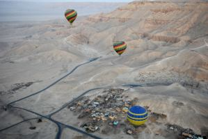 Tourists in hot air balloons flying during dawn across Egypt's Valley of the Kings, near Luxor. Hot air balloon rides in Luxor will resume on Thursday morning, two months after the death of 19 tourists onboard a balloon ride which resulted in the grounding of all hot air balloons  (AFP Photo/Charles Onians)