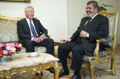 US Secretary of Defense Chuck Hagel (L) speaks with Egypt's President Mohamed Morsi at the Presidential Palace in Cairo on April 24, 2013. Hagel landed in Egypt as part of a Middle East tour designed to bolster America's alliances amid growing concern over the fallout from Syria's roiling civil war. (AFP Photo/POOL/JIM WATSON)