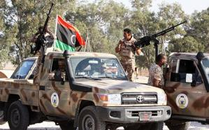 Soldiers in pickup trucks mounted with machineguns and anti-aircraft weapons were deployed in Tripoli (AFP Photo)