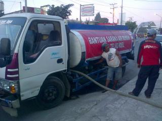 Bantuan Air bersih untuk pengungsi sinabung, kerjasama Telkomsel - PKPU (Foto: PKPU)