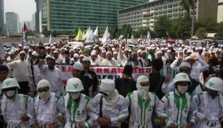 Massa FPI dalam sebuah aksi unjuk rasa.  (viva.co.id)