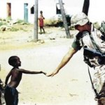 Boy greeting Soldier in Africa.
