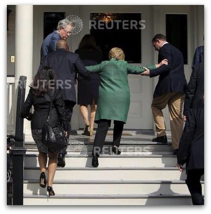 Hillary being helped up stairs stroke