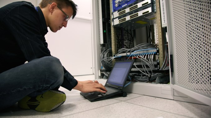 Young IT engineer getting valuable on-the-job training
