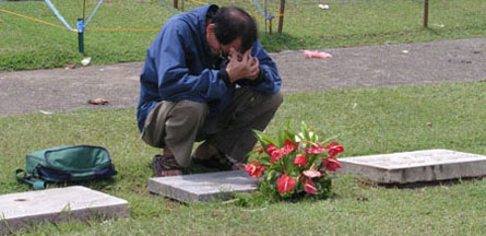 A man mourns at the Davao Memorial cemetery. (Photo by Barry Ohaylan)