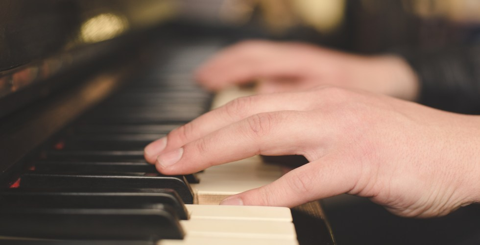 Hands playing piano close-up oldschool vintage instagram filter