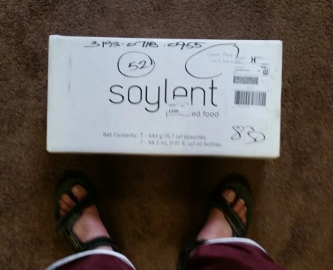A picture of my box of soylent...and of course, my feet, b/c I'm talented with cameras like that.