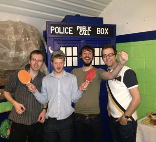 Photo of The Young'uns and Sam Carter wearing Viking Helmets, holding table tennis rackets, standing next to a TARDIS and huge ornamental elephant