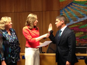 Alan Fernandes is Sworn-in by Board President Gina Daleiden in May