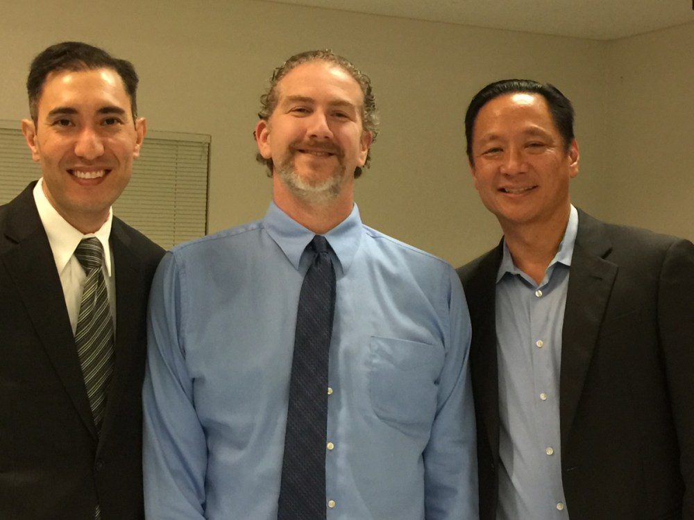 Jeff Adachi (right) poses next to Phil Telfeyan (left) and Vanguard Director David Greenwald (center)
