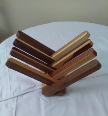 Wooden display rack by John Kara