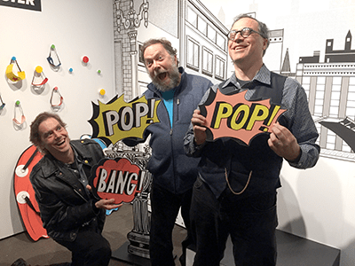 KBOO-FM host S. W. Conser, Patrick Rosenkranz, and me at the nearby Oregon Historical Society Comics City, USA exhibit