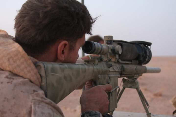 Sgt. Michael Weaver, Personal Security Detail, Regimental Combat Team 5, uses a Mk. 11 assault rife equipped with a Magnum Universal Night Sight (MUNS) to spot activity along the Syrian border during Operation Al Anbar Border Initiative (AABI), north of Al Qiam, Iraq on Oct. 12, 2008.  U.S. Marine Corps photo by Cpl. Tyler W. Hill