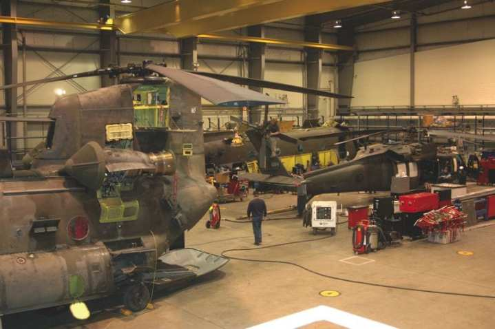 A hangar on Mannheim, Germany's Coleman Barracks, one of AFMD's non-enduring Reset sites, is filled with CH-47 Chinook and UH-60 Black Hawk helicopters undergoing a Reset after redeployment. The Reset program encompasses hours of work to get the aricraft back to Army standards before being returned to their units. U.S. Army photo by Kristen Marquez, USAG Baden-Wurttenberg Public Affairs Office.