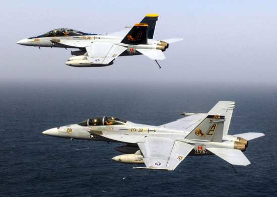 "Two F/A-18F Super Hornets assigned to the ""Swordsmen"" of VFA-32 during flight operations aboard the Nimitz-class aircraft carrier USS Harry S. Truman (CVN 75) in 2008. Truman and embarked Carrier Air Wing (CVW) 3 were on a scheduled deployment supporting Operations Iraqi Freedom, Enduring Freedom and maritime security operations. Congress authorized a buy of 18 more Super Hornets to help close a looming Navy ""fighter gap.""  U.S. Navy photo by MC3 Ricardo J. Reyes."