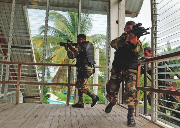 Members of the Guatemalan Navy Special Forces conduct a room clearance during a close quarters battle training evolution provided by an Expeditionary Training Command (ETC) mobile training team.  Naval Special Warfare Anchor Teams will conduct such training, as well as other host nation support, on a prolonged rather than a temporary basis. U.S. Navy photo by Mass Communications Specialist 2nd Class Paul D. Williams.