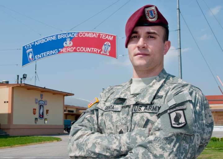 U.S. Army Staff Sgt. Salvatore Giunta, of the 173rd Airborne Combat Team in Vicenza, Italy, poses in front of his headquarters May 25, 2010. Giunta was awarded the Medal of Honor, the nation's highest military valor decoration, for his heroic acts during an enemy engagement in Korengal Valley, Afghanistan, in October 2007. U.S. Army photo by Richard Bumgardner.