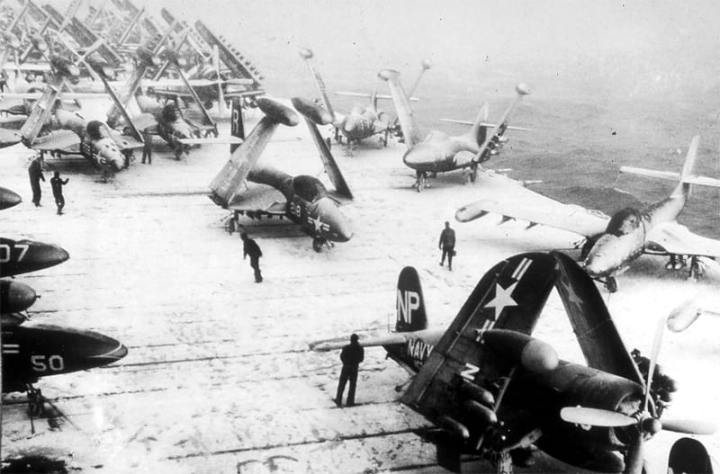 A blinding snow storm idles Task Force 77 off the Korean coast on Jan. 18, 1952. On deck aboard USS Essex (CV 9), F2H Banshees, F4U Corsairs, and F9F Panthers are shrouded in snow. National Archives photo