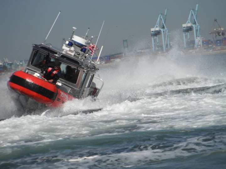 A boatcrew from Coast Guard Maritime Safety and Security Team Los Angeles-Long Beach, Calif., conducts tactical maneuvers in a response boat-small, while enforcing a moving security zone in Long Beach Harbor, Oct. 7, 2010. U.S. Coast Guard photo by Petty Officer 3rd Class Thomas Hartung