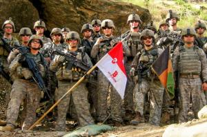 Members of Red Platoon, 3-61 Cavalry Regiment, including Staff Sgt. Clint Romesha (front row, second from right), pose for a picture just after arriving at Combat Outpost Keating, Nuristan Province, Afghanistan, 2009. U.S. Army photo by 1st Lt. Brad Larson