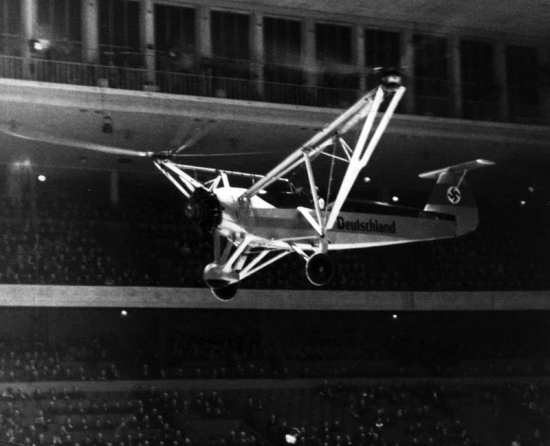 German test pilot Hanna Reitsch (1912-1979) demonstrates a Focke-Achgelis Fa 61 helicopter in the Deutschlandhalle arena in Berlin, Feb. 19, 1938. Bundesarchive photo