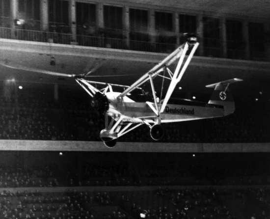 German test pilot Hanna Reitsch (1912-1979) demonstrates a Focke-Achgelis Fa 61 helicopter in the Deutschlandhalle arena in Berlin, Feb. 19, 1938. Bundesarchive photo