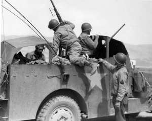 Lt. Gen. George S. Patton (second from right) personally directs the drive toward Gabes, Tunisia in a M3A1 scout car, March 15, 1943. General George Patton Museum photo