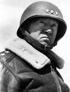Lt. Gen. George S. Patton at the front viewing troops, south of El Guetter, Tunisia. General George Patton Museum photo