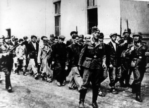 German soldiers escort people from Kragvjevac and its surrounding area to be executed, October 1941. United States Holocaust Memorial Museum photo courtesy of Muzej Revolucije Naroda i Narodnosti Jugoslavije