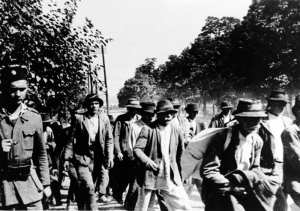 Serbs and Gypsies who have been rounded up for deportation are marched to the Jasenovac concentration camp under Ustasa guard. United States Holocaust Memorial Museum photo courtesy of Muzej Revolucije Naroda i Narodnosti Jugoslavije