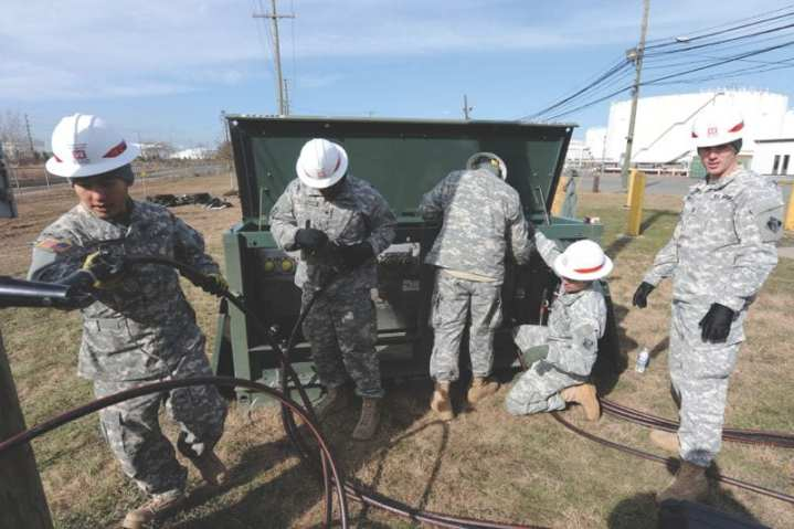 Soldiers with C Company, 249th Engineer Battalion (Prime Power), install electrical generator equipment at a Carteret, N.J., fuel depot that lost power during Hurricane Sandy, Nov. 6, 2012. The 249th is a one-of-kind unit within the government whose mission is to deploy worldwide to provide power and electrical systems to support Army details and disaster relief operations. DoD photo by E.J. Hersom